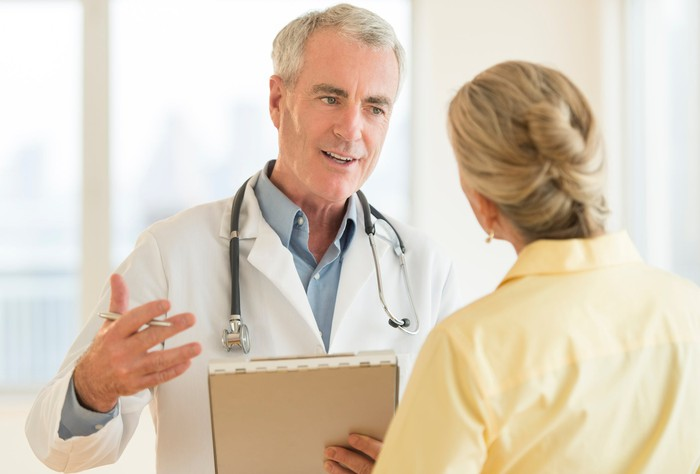 A doctor explaining something to a patient.