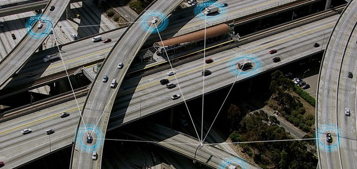 Picture of highway with technology encircling some cars.