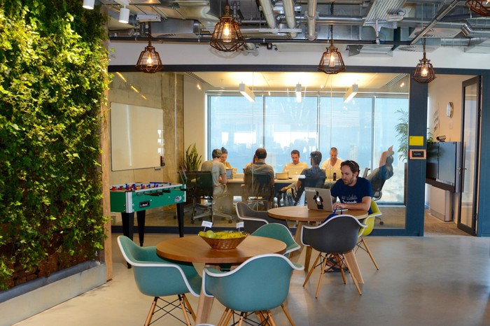 Workers meet in a conference room at Facebook's offices in Tel Aviv