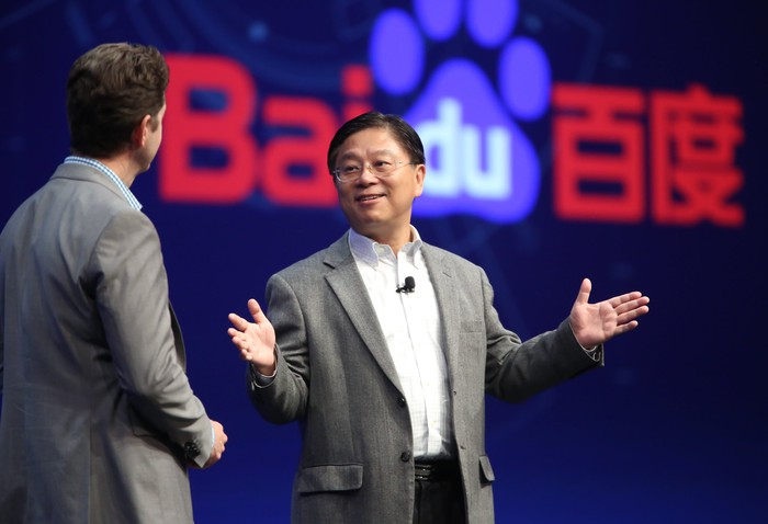 Jing Wang, senior vice president of Baidu, on stage with Baidu logo behind him