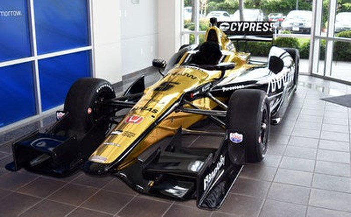 The IndyCar Honda No. 5. The gold car is parked in a garage with the name Cypress displayed on the rear spoiler.