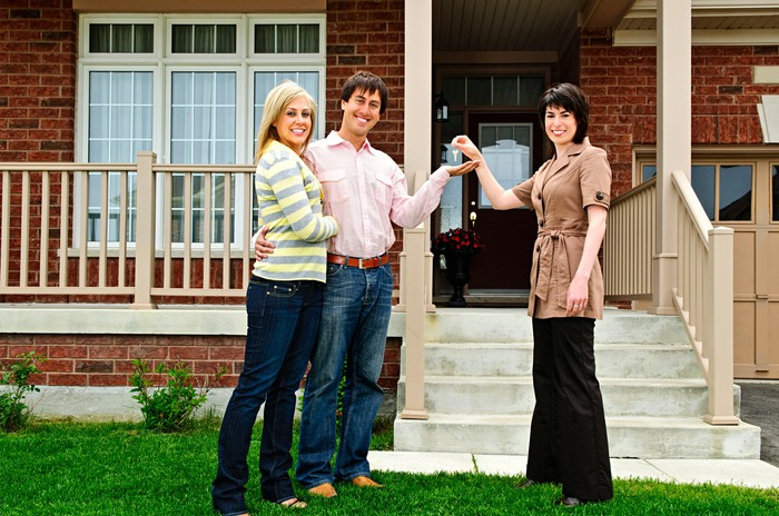 Couple and realtor at a mortgage closing