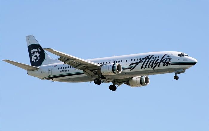 An Alaska Air plane in flight.