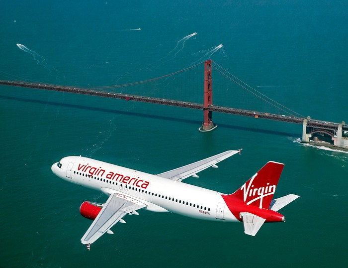 Virgin America plane flying near the Golden Gate bridge.