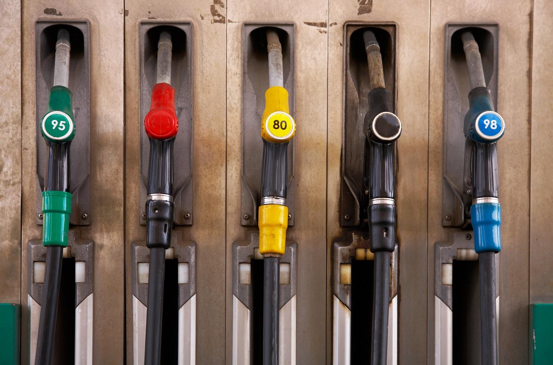 Fuel pump nozzles at a gas station.
