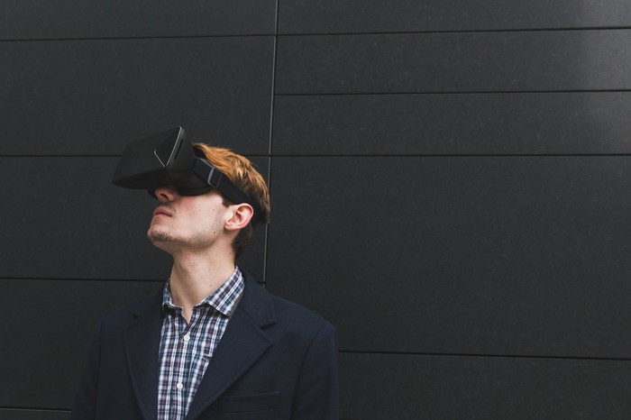 Young man wearing a virtual reality headset.