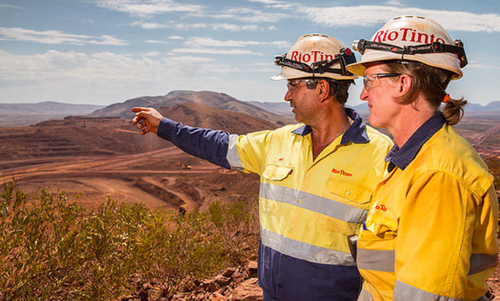 Rio Tinto employees looking out over the land.
