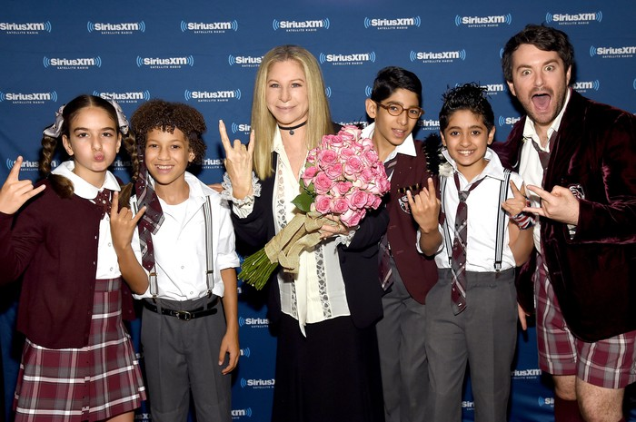 Barbara Streisand with the cast of Broadway's School of Rock musical.