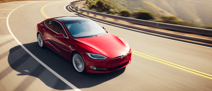 Red Model S driving