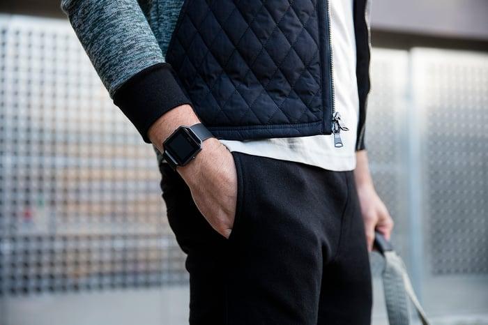 Man wearing a Fitbit Blaze waiting in a train station