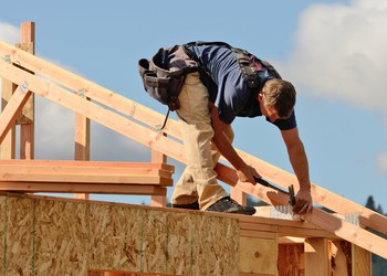 Homebuilding Industry Construction Worker on Roof