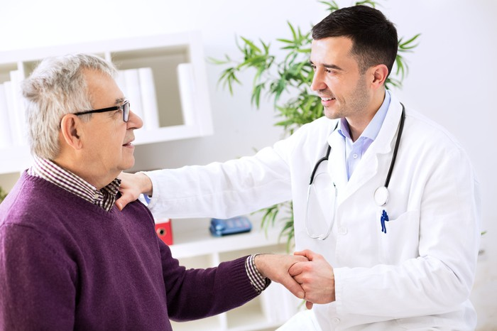 Older patient with doctor