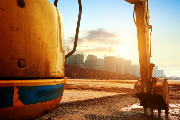 Construction equipment during sunrise