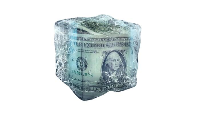 Dollar bills inside a block of ice