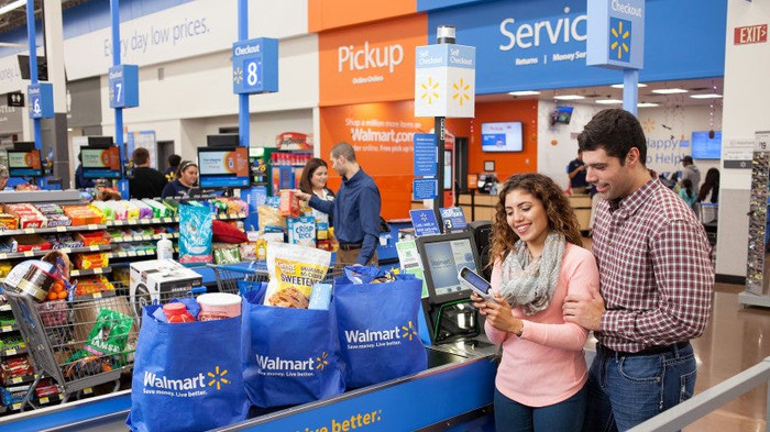 Two people checking out at a Wal-Mart store.