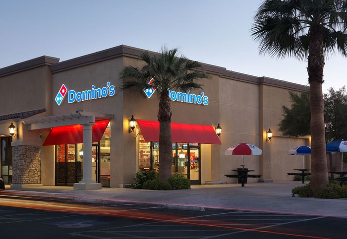 The outside of a Domino's.