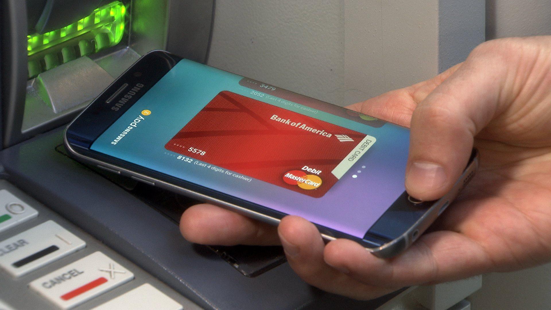 A consumer using a digital Bank of America debit card.