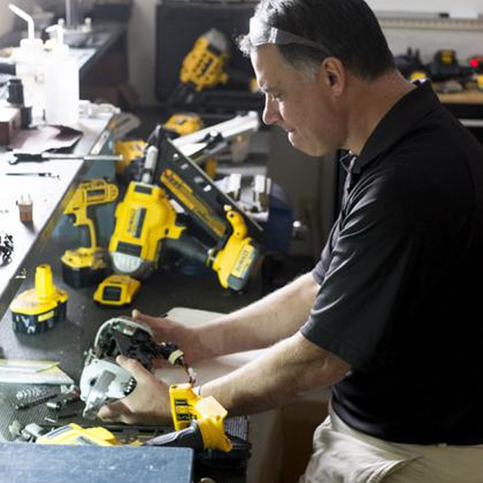 Man looking at Stanley Black & Decker's DeWalt line of tools