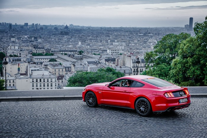 Ford's Mustang parked with a view of a French city.