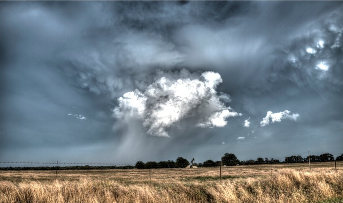 A storm brewing over an oil well