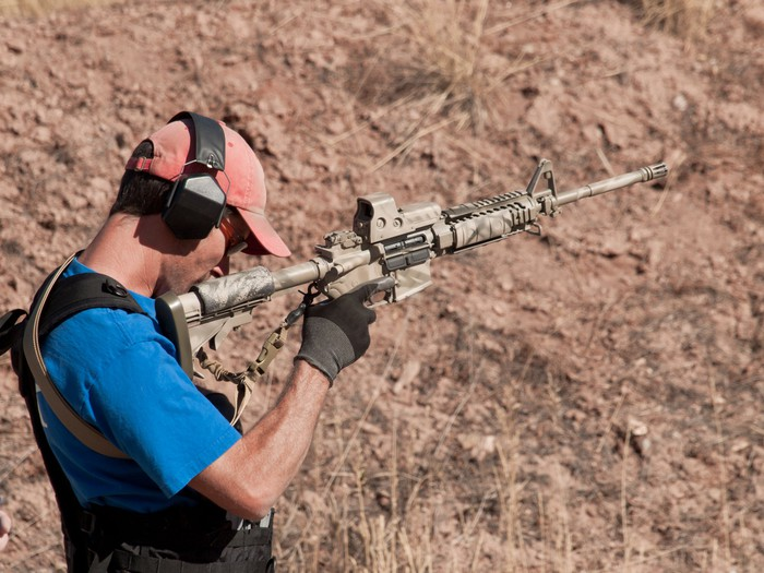Man target shooting with a modern sporting rifle