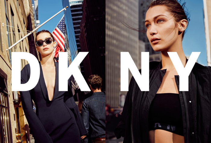 A woman posing in front of New York skyscrapers in a DKNY advertisement.