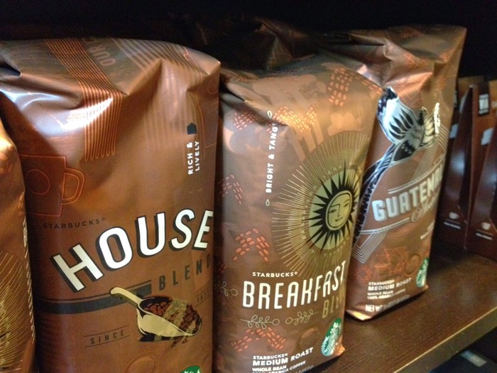 A row of Starbucks coffee bags
