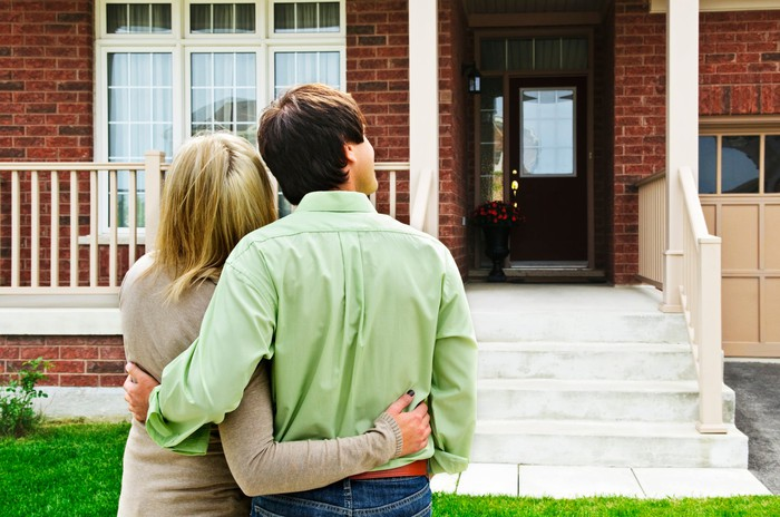 Couple looking at a house to buy