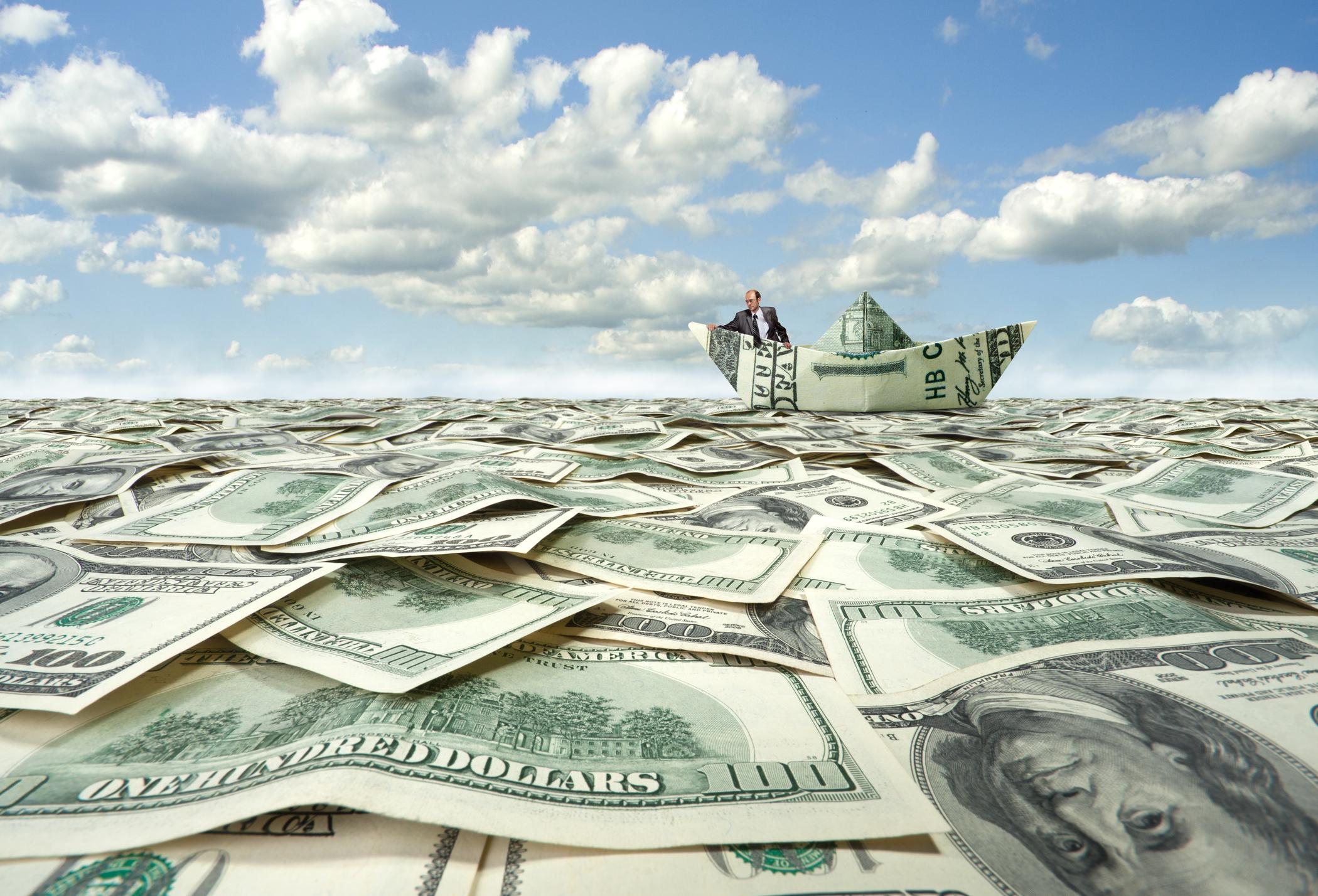 Money boat on sea of cash.