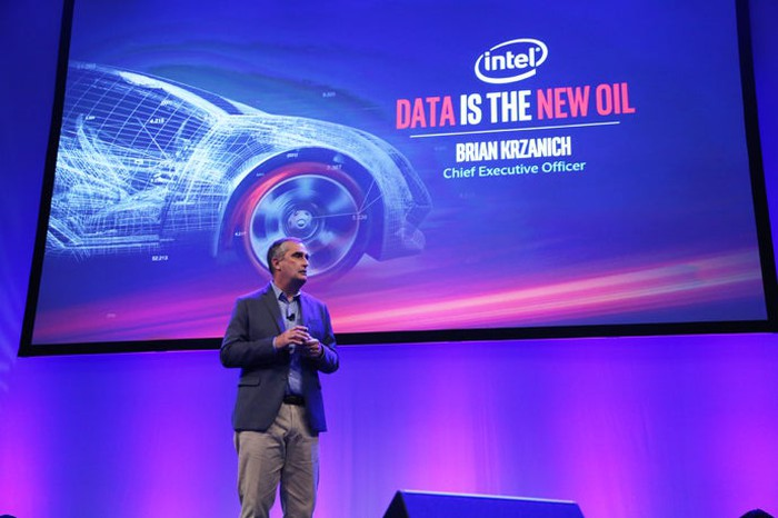 Intel CEO Brian Krzanich presenting on stage at an automotive conference