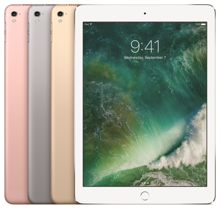 Apple's iPad Pro in rose gold, space gray, and gold, with the silver iPad's display facing forward.
