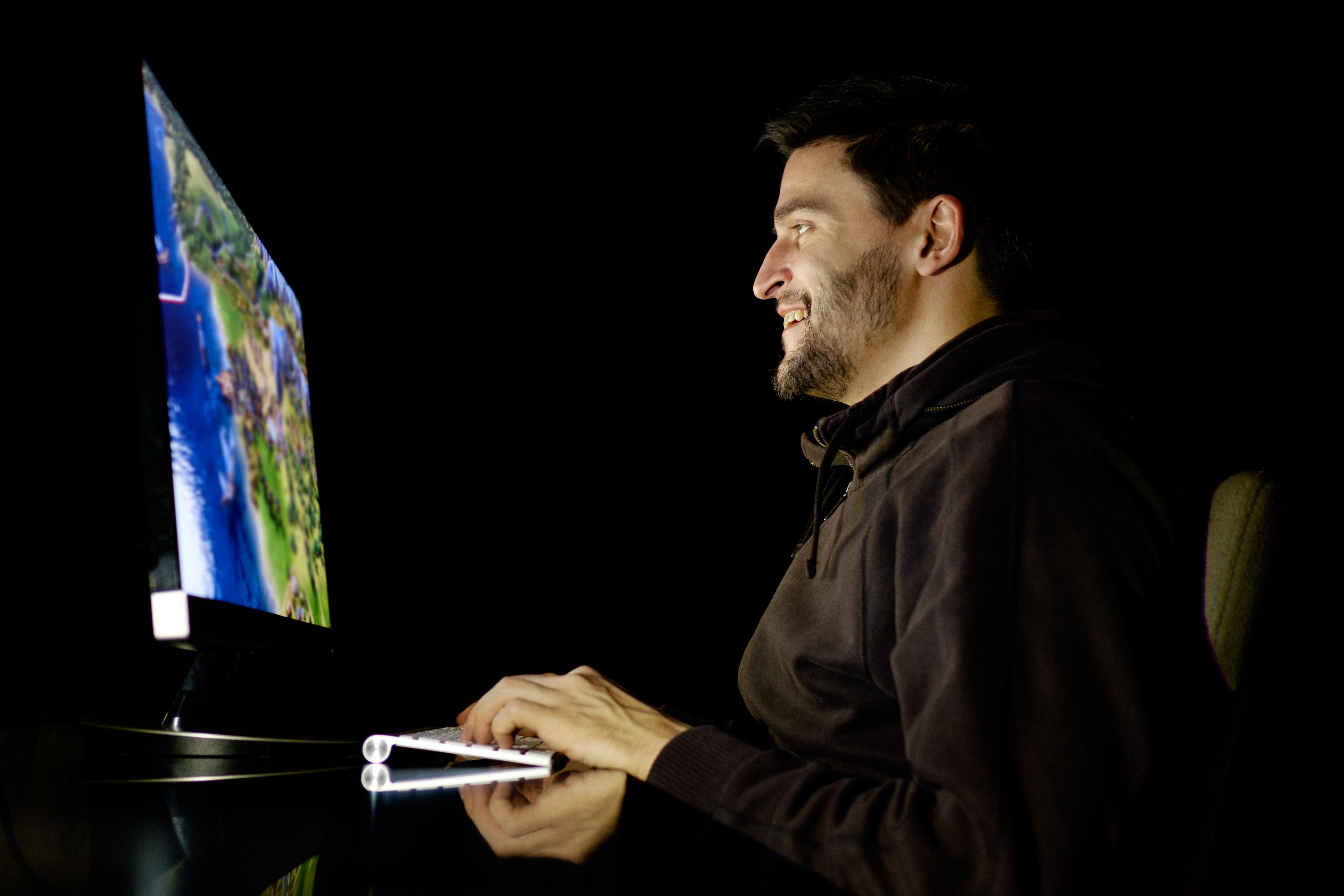 Man playing computer games.