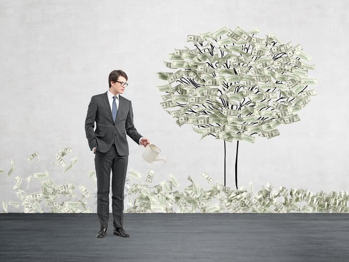 "A businessman plants a ""money tree."""