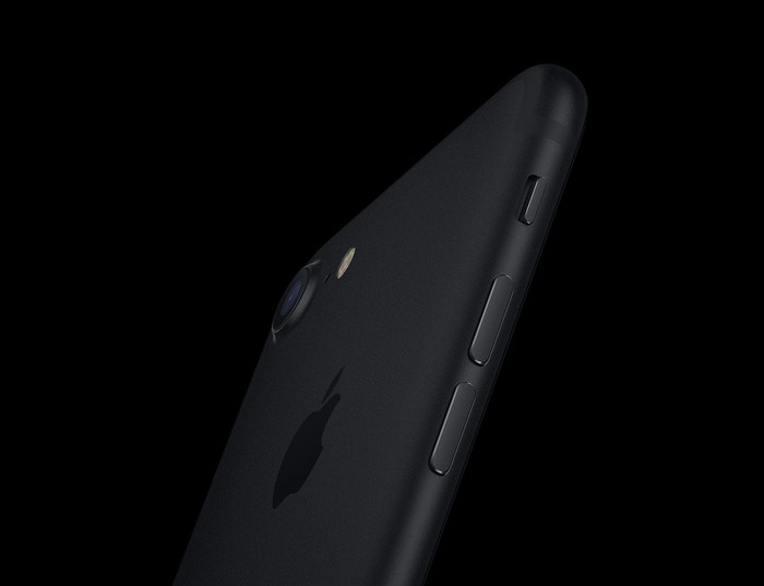 The iPhone 7 in black against a black background.
