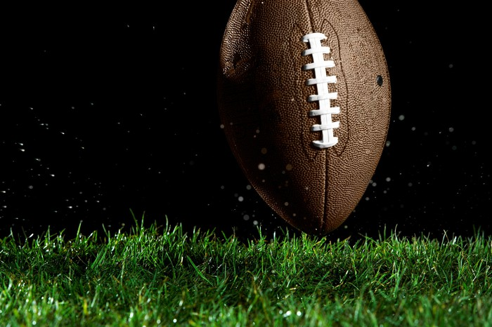 A football on turf.