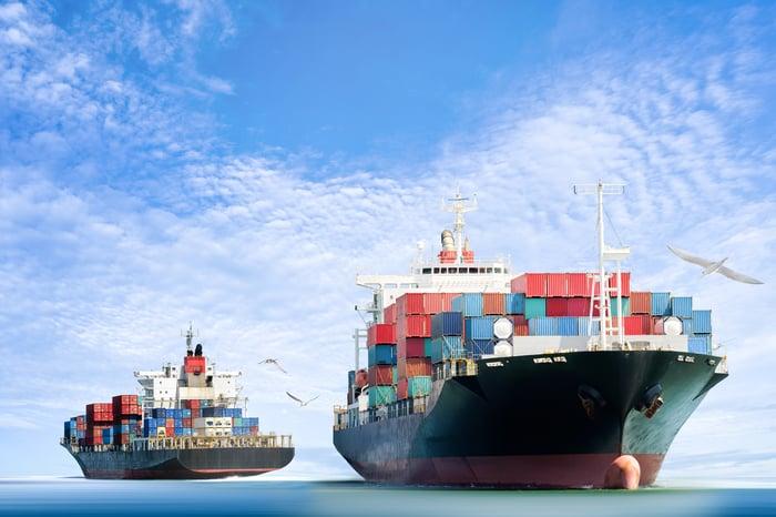 Dry bulk ships traveling on an open ocean.