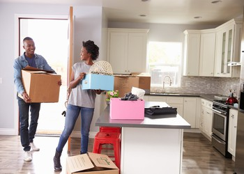 young couple moving into new house home