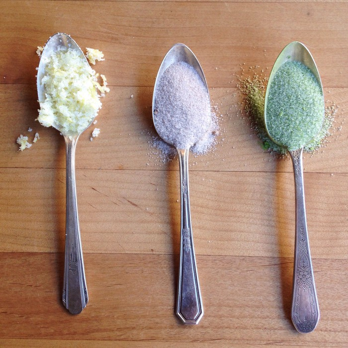 Three spoons with different spices.