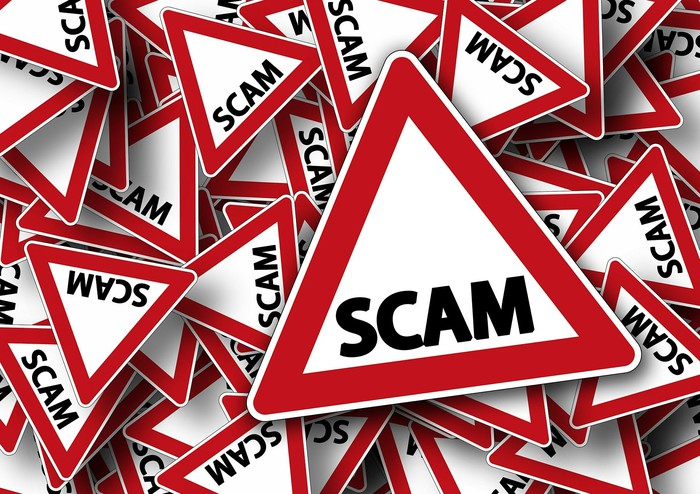 "A jumble of red and white triangles, with the word ""scam"" on each"