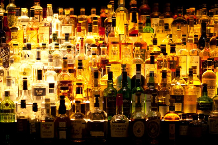 Bar filled with liquor bottles.