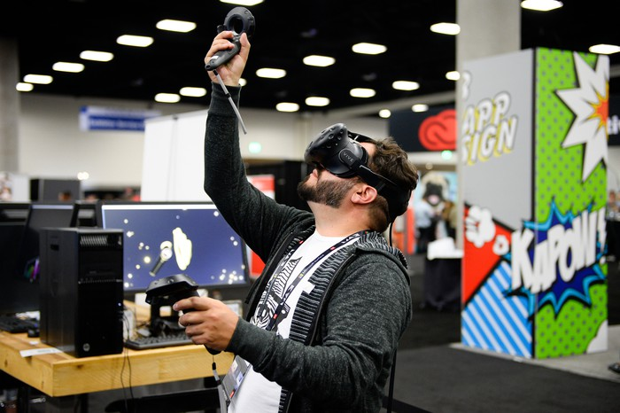 A man wearing a virtual-reality headset looks overhead.