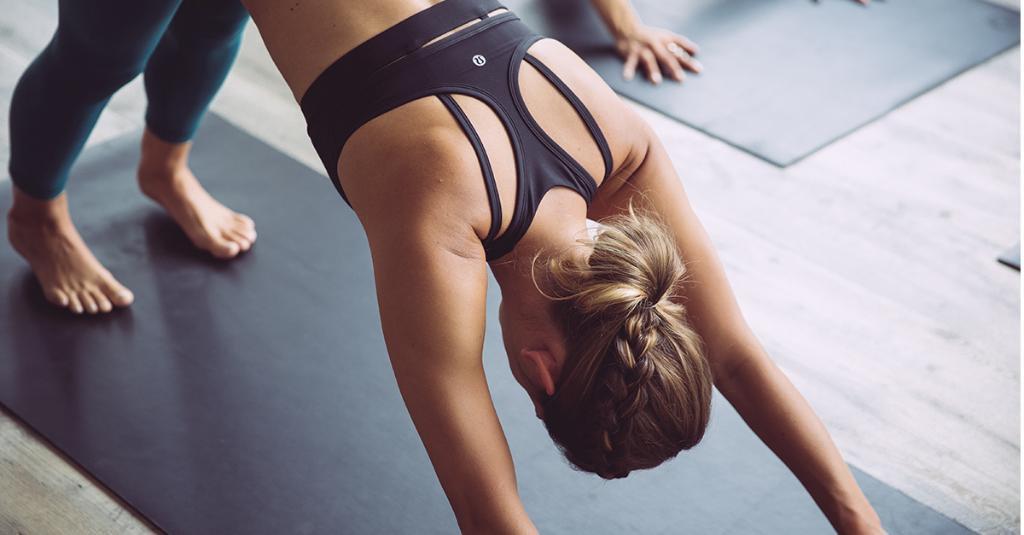 A woman doing yoga in Lululemon apparel.