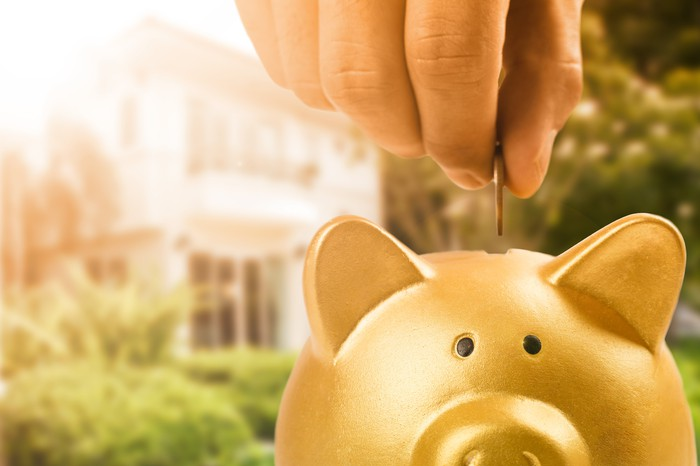 Piggy bank in front of a home