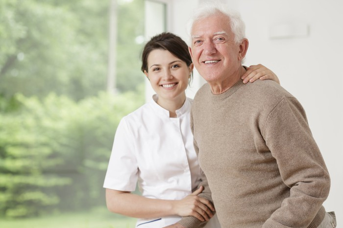 Assisted living worker with elderly man