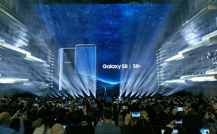 Galaxy S8 and S8+ projected on a large screen in front of a packed auditorium.