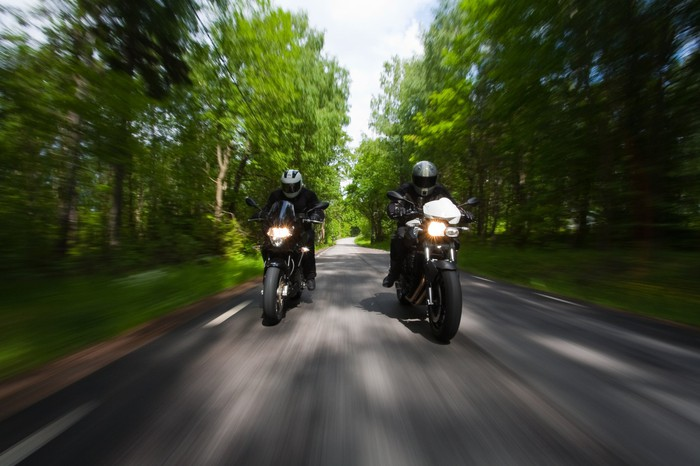 Motorcycles racing in the forest