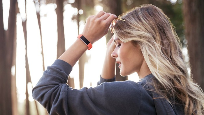 A model wearing the Fitbit Alta HR wristband.
