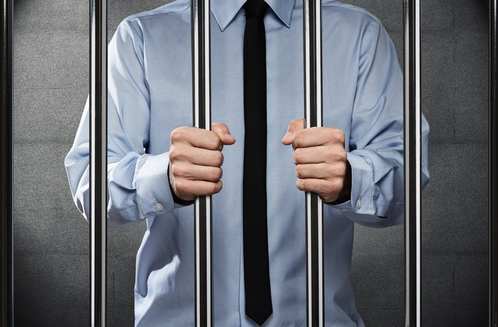 Businessman in jail.