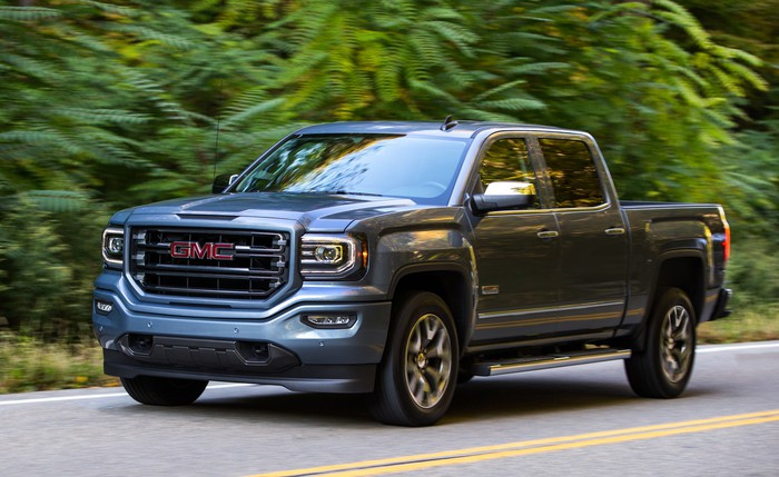 A GMC Sierra 1500 on a country road.