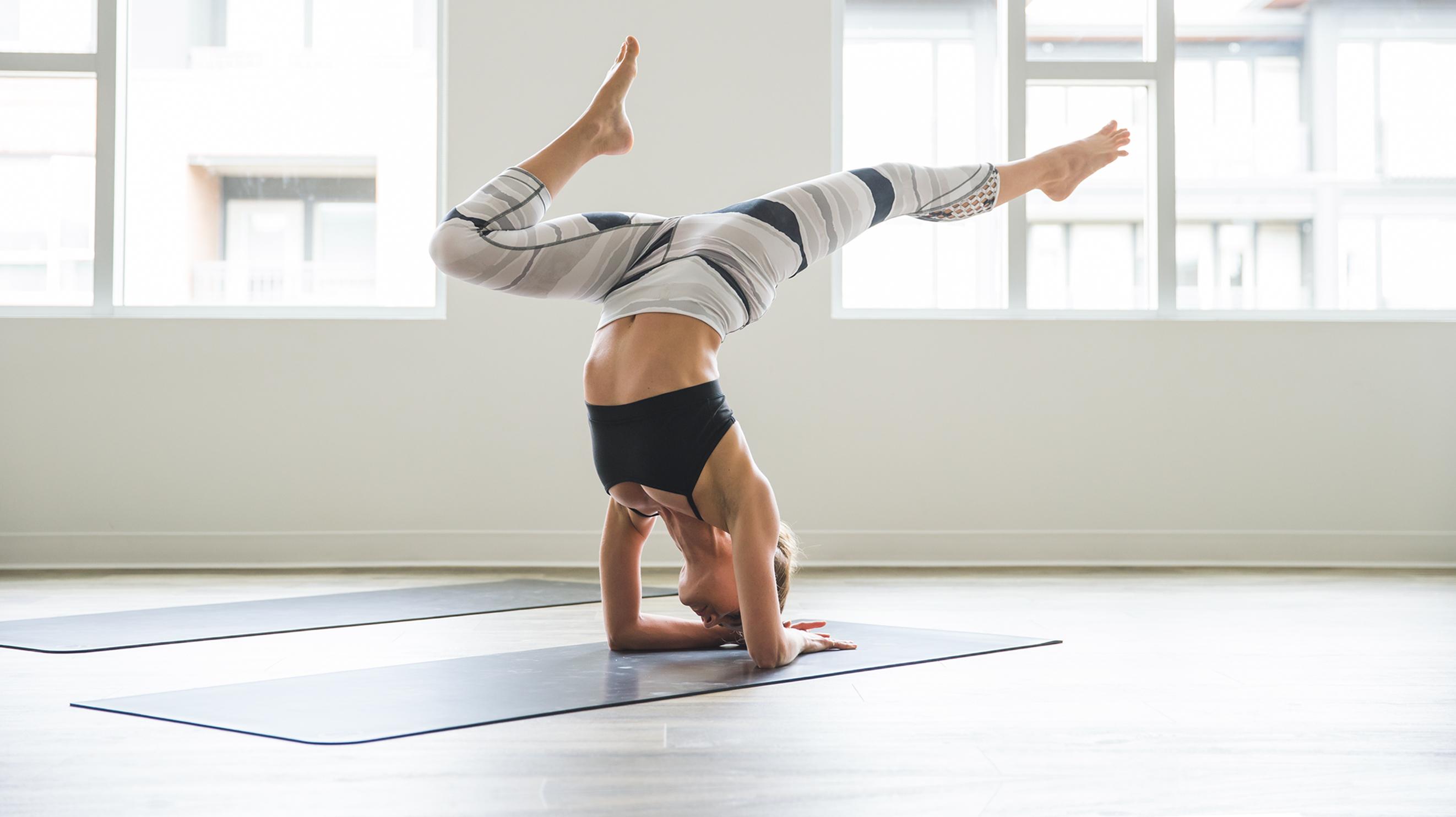 Woman wearing Lululemon clothing while practicing yoga.